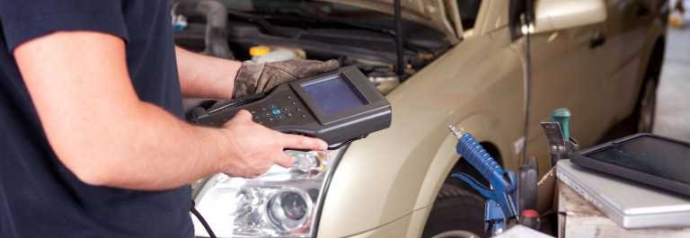 A mechanic running a diagnostic check